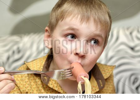 Kid Eating Spaghetti With Sausage