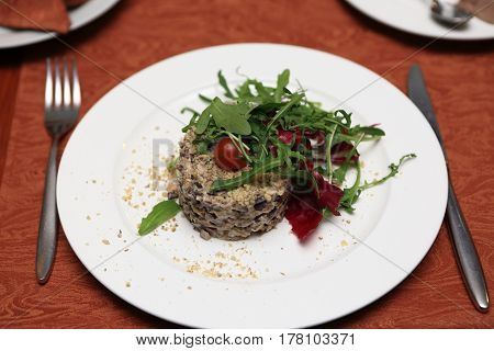 Meat salad on plate in a restaurant