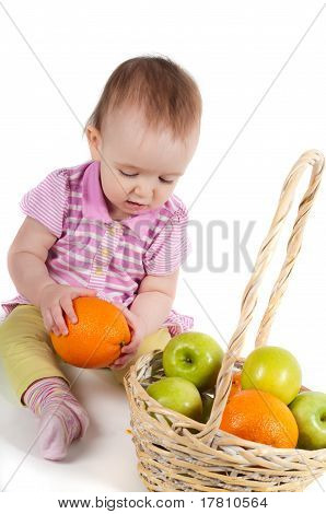 Baby girl in pink and fruits