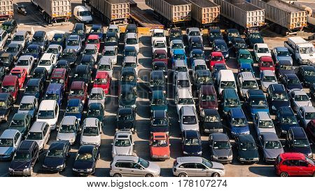 Parked cars at the busy Port of Savona Italy.