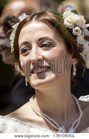 CAGLIARI, ITALY - May 29, 2016: Sunday at La Grande Jatte VIII Ed. At the Public Gardens - portrait of a beautiful woman in Victorian costumes - Sardinia