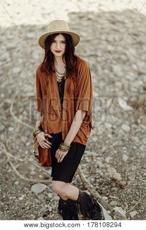 Beautiful Stylish Boho Woman Hipster With Hat, Leather Bag, Fringe Poncho And Boots. Girl In Gypsy H