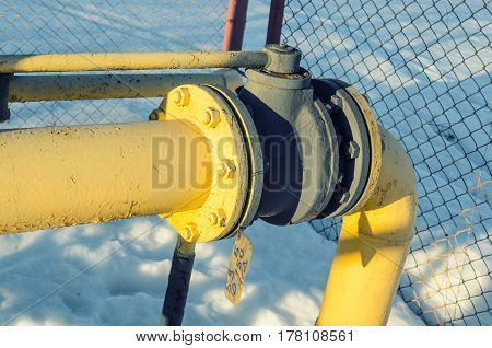 Pipes of gas equipment and shut-off valve, leaving into the ground