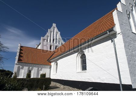 Closeup old traditional Danish white village church in Fons on Funen.