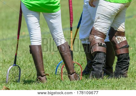 Polocrosse Players Closeup Walking Boots Rackets
