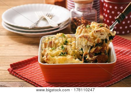 Bread casserole with chicken, spinach,eggs and cheese known as strata.