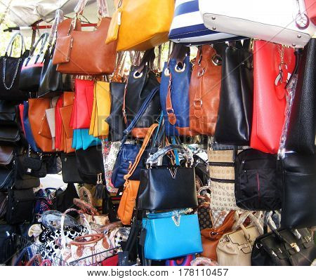 ROME, ITALY - AUGUST 9, 2016: Fake designer fashion bags at the city center market in Rome, Italy. Popular place for shopping good or bad quality bags in italian capital