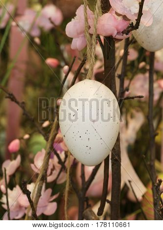 Easter Egg Hanging From A Branch With Pink Flowers