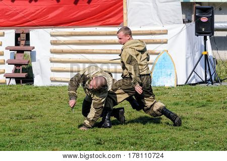 Tyumen, Russia - September 22, 2012: Avanpost training center on preparation of school students for army. Miles of Fire festival of live history. Performance of special troops. Work against knife