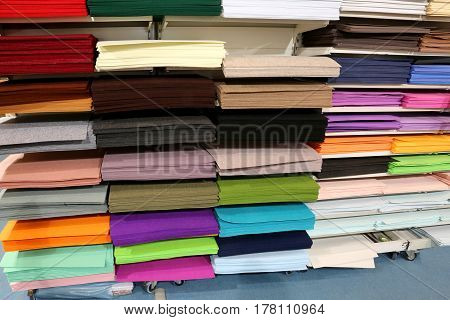 Interior of a shop for tailors material and hobby with the shelf full of fabrics and felts