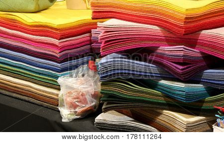 pile of fabrics and of felt for sale in the haberdashery and hobby shop