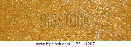 horizontal background yellow golden glitter very bright