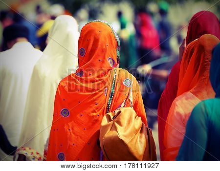 Sikh Women With Veils Over Their Heads During The Procession In