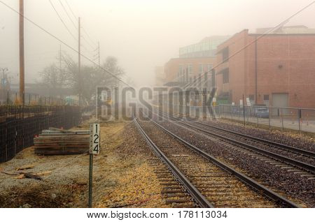 listening to the train whistle in the fog