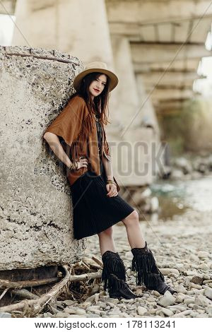 Beautiful Stylish Boho Woman With Hat, Fringe Poncho And Boots. Girl In Gypsy Hippie Look Young Trav