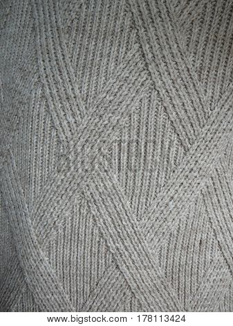 Closeup of pattern in Grey knitted sweater