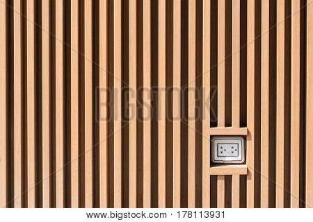 Plug Socket On Light Brown Wooden Wall Pattern At Outdoor Installation