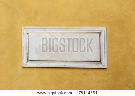 White Marble Classic Blank Nameplate With Empty Space For Text And Numbers Centered On Yellow Painte