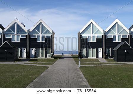 ASSENS DENMARK - MARCH 24 2017: Modern designed Danish terraced summer houses by the sea. March 24 2017 Assens Funen Denmark.