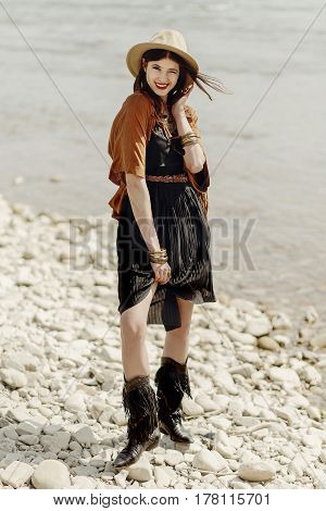 Beautiful Stylish Boho Woman Smiling, With Hat, Fringe Poncho And Boots. Girl In Gypsy Hippie Look Y