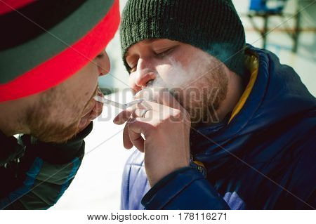 Man Asked To Light A Passerby From A Cigarette, The Mutual Use Of Smokers On The Street