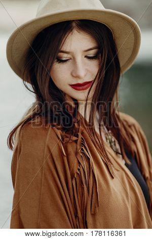 Beautiful Stylish Boho Woman With Hat, Fringe Poncho. Girl In Gypsy Hippie Look Young Traveler Posin