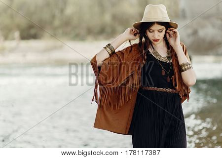 Stylish Hipster Gypsy Boho Woman Posing In Hat With Windy Hair, In Fringe Poncho And Accessory.  Tra