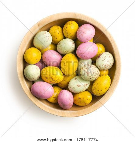 Sweet easter eggs in bowl isolated on white background.