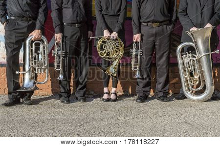 brass instruments and the hands that play them