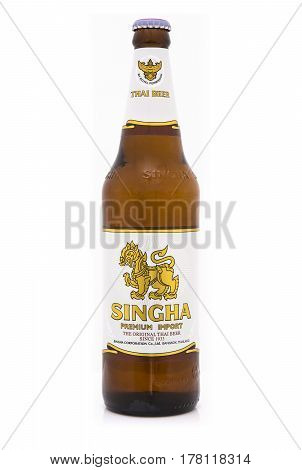 SWINDON UK - MARCH 25 2017: Bottle of Singha Premium Import lager beer on white background Singha is the original Thai Beer since 1933