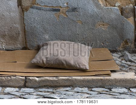 dirty pillow on a paper-box matrass in the strret of Lisbon