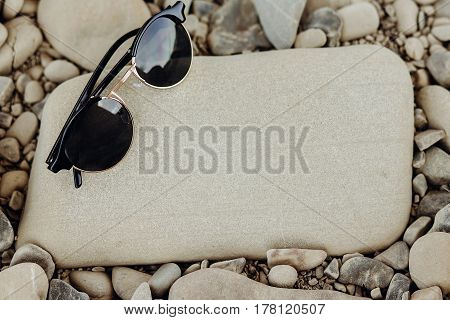 Wanderlust And Travel Concept. Stylish Hipster Sunglasses On Beach Top View With Space For Text. Sum