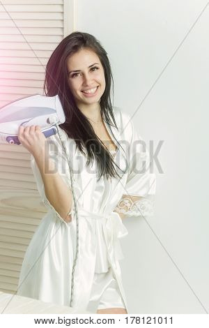 Happy Pretty Girl Or Housewife Smiling With Iron In Hand