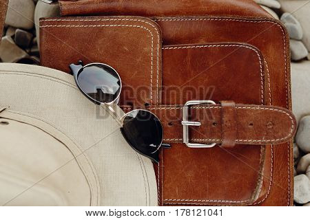 Stylish Hipster Sunglasses Hat And Leather Bag On Beach With Space For Text, Top View. Wanderlust An
