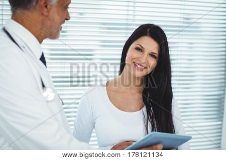 Pregnant woman interacting with doctor in clinic