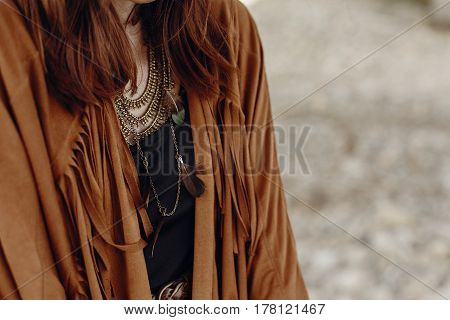 Stylish Boho Woman Look. Gypsy Hipster Girl In Fringe Jacket With Feather Bronze Accessory. Wanderlu
