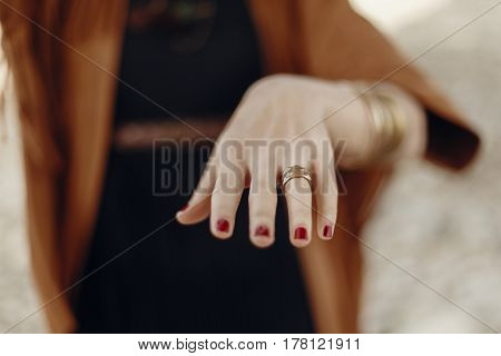 Stylish Boho Woman Showing Hand With Rings. Gypsy Hipster Girl In Fringe Jacket With Modern Bronze A