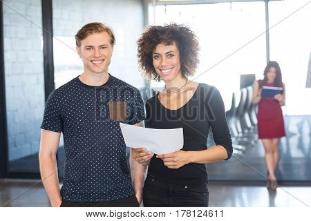 Portrait of business executives standing together and smiling in office