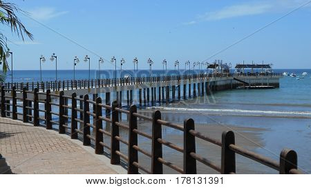Pacific Ocean Pier and Promenade boardwalk in Ecuador