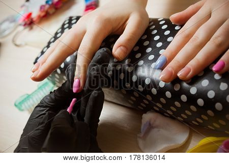 Process of made blue and pink manicure step by step