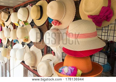 Group of hat for summer beach vacation hang on the rack
