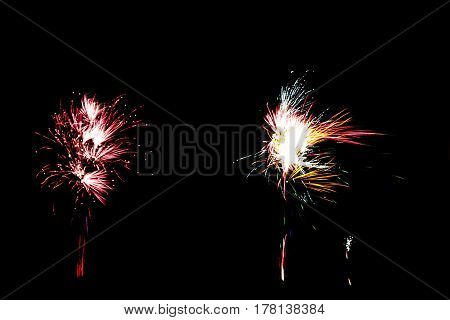 Double exploding fireworks in multiple colours at night