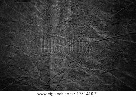 Texture of dark grey crumpled cotton abstract textile background with copyspace
