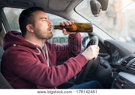 Drunk Man Driving Car And Drinking Alcohol