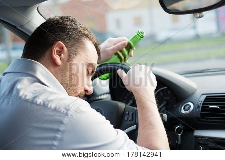 Man Driving Car And Drinking Alcohol