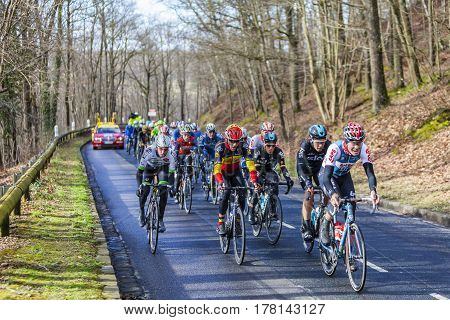 Cote de Senlisse France - 5 March 2017: Image of the peloton in full effort climbing on Cote de Senlisse during the first stage of Paris-nice on 05 March 2017.