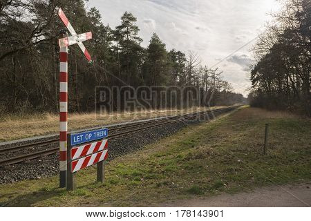 Unguarded light rail railway crossing without barriers and warning lights in the East of the Netherlands