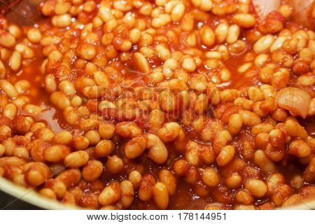Freshly cooked baked haricot beans in a tomato and onion sauce.