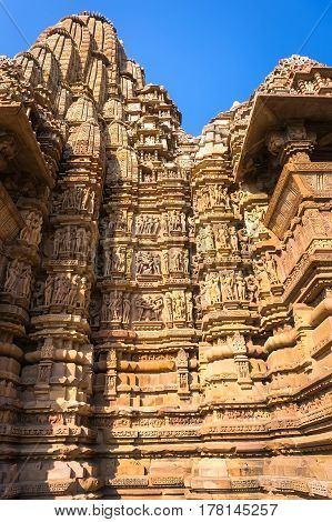 Famous Historic Monumant With Erotic Theme On Sculptured Wall Of Indian Temple Of Khajuraho.