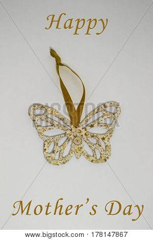 A golden handmade butterfly ready for decoration